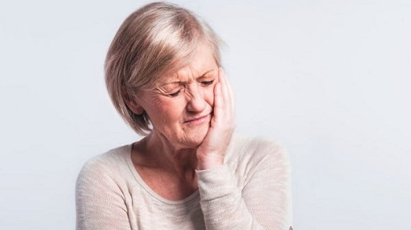 What are the symptoms of dental pain
